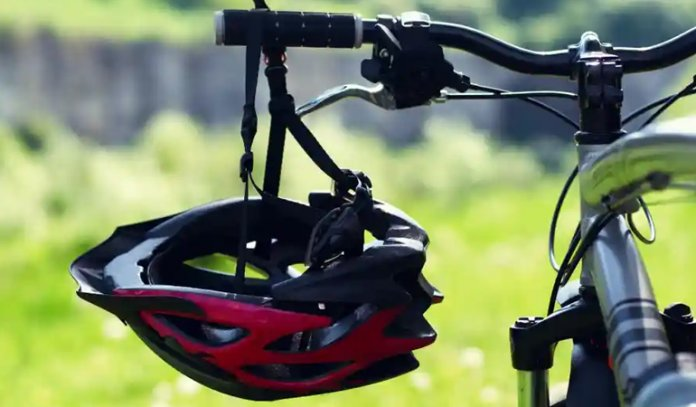 Is it illegal to ride a bike without a helmet in the USA?
